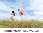 happy girl holding colorful of... | Shutterstock . vector #569797060