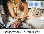 bride and bridegroom sitting in ... | Shutterstock . vector #569801590