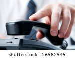 male hand holding phone... | Shutterstock . vector #56982949
