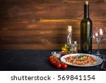 italian dinner | Shutterstock . vector #569841154