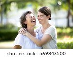 laughing senior mother and teen ... | Shutterstock . vector #569843500