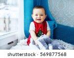 little baby sitting on the... | Shutterstock . vector #569877568