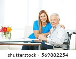 woman and senior man filling... | Shutterstock . vector #569882254