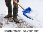 man removing snow from the... | Shutterstock . vector #569904409