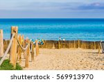 Small photo of Idyllic view of the sandy beach Cala Agulla, Majorca Spain, Mediterranean Sea Island.