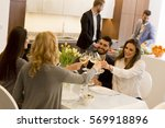 friends sitting at a dining... | Shutterstock . vector #569918896
