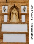 Small photo of Stone altar with the figure of the saint protector of the Virgin in a street of Cordoba.