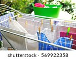 freshly washed clothes drying...   Shutterstock . vector #569922358