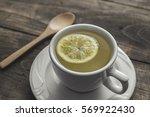 tea cup with lemon on wooden... | Shutterstock . vector #569922430