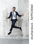 businessman jumping in air ... | Shutterstock . vector #569923060