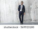 smiling man in sharp suit ... | Shutterstock . vector #569923180