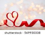 red ribbon still heart....   Shutterstock . vector #569930338