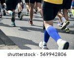 legs of running men | Shutterstock . vector #569942806