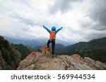 successful woman hiker open... | Shutterstock . vector #569944534