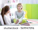 young female psychologist... | Shutterstock . vector #569947096