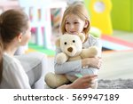 young female psychologist... | Shutterstock . vector #569947189