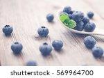 fresh blueberry on wooden... | Shutterstock . vector #569964700