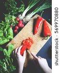 female slicing pepper for... | Shutterstock . vector #569970880