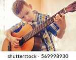 boy learning to play the... | Shutterstock . vector #569998930
