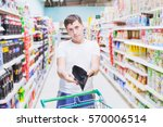 man showing empty wallet in... | Shutterstock . vector #570006514