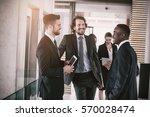 happy businessmen having... | Shutterstock . vector #570028474