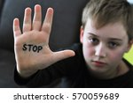 small abused boy holding his... | Shutterstock . vector #570059689