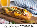 hot dog with cheese and beer   Shutterstock . vector #570070954