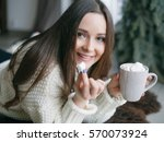 beautiful young woman with cup...   Shutterstock . vector #570073924