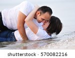 happy couple lying in the water ... | Shutterstock . vector #570082216