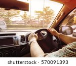 man control steering wheel with ... | Shutterstock . vector #570091393