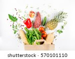 paper bag full of healthy food... | Shutterstock . vector #570101110