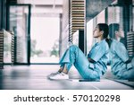 side view of nurse sitting on...   Shutterstock . vector #570120298