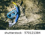 snorkeling mask on stone  ...   Shutterstock . vector #570121384