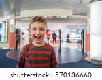 happy and excited boy in front... | Shutterstock . vector #570136660