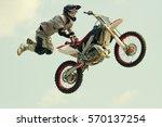 biker acrobatic jump at the... | Shutterstock . vector #570137254