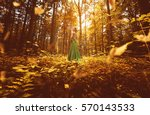 woman with green dress in an... | Shutterstock . vector #570143533
