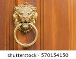 Golden Door Knocker In The...