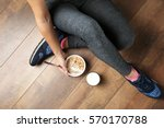 woman sitting on the floor with ... | Shutterstock . vector #570170788