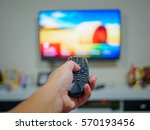 close up hand holding tv remote ... | Shutterstock . vector #570193456