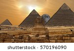 Small photo of Pyramids of Giza and sphinx with a poster / marbled effect added in sepia