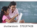 teacher and student at laptop ... | Shutterstock . vector #570197428