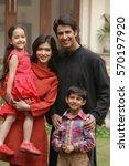 family of four outdoor portrait ... | Shutterstock . vector #570197920