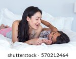 woman relaxing with her... | Shutterstock . vector #570212464