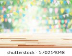 empty wooden table with party... | Shutterstock . vector #570214048