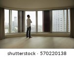 rear view of young man looking...   Shutterstock . vector #570220138