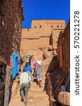 Small photo of Ait Benhaddou, Morocco - March 3, 2016: People walk up the stairs in the walled city of Ait Benhaddou, Morroco, Africa