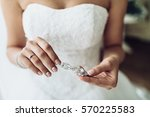 elegant bride holding silver... | Shutterstock . vector #570225583
