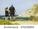 aged couple looking sea | Shutterstock . vector #570230893