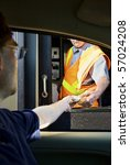 Man Paying Money At Toll Booth