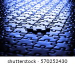 Small photo of Puzzle pieces on a table representing a game to play or complete